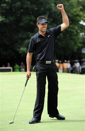 JOHANNESBURG, SOUTH AFRICA - JANUARY 17:  Charl Schwartzel of South Africa celebrates winning the Joburg Open at Royal Johannesburg and Kensington Golf Club on January 17, 2010 in Johannesburg, South Africa.  (Photo by Stuart Franklin/Getty Images)