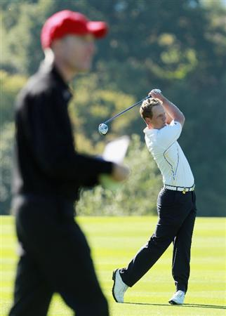 NEWPORT, WALES - OCTOBER 04:  Luke Donald of Europe hits an approach shot on the 11th hole watched by Jim Furyk of the USA in the singles matches during the 2010 Ryder Cup at the Celtic Manor Resort on October 4, 2010 in Newport, Wales. (Photo by Andrew Redington/Getty Images)
