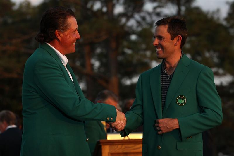 AUGUSTA, GA - APRIL 10:  Phil Mickelson presents Charl Schwartzel of South Africa the winner's jacket at the green jacket presentation after Schwartzel's two-stroke victory at the 2011 Masters Tournament at Augusta National Golf Club on April 10, 2011 in Augusta, Georgia.  (Photo by Andrew Redington/Getty Images)