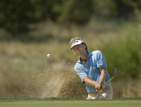 SUNRIVER, OR - AUGUST 17: Bernhard Langer hits his second shot from a greenside bunker at the par-3 third hole, during the fourth round of the Champions Tour JELD-WEN Tradition at the Crosswater Club on August 17, 2008 in Sunriver, Oregon. (Photo by Steven Gibbons/Getty Images)