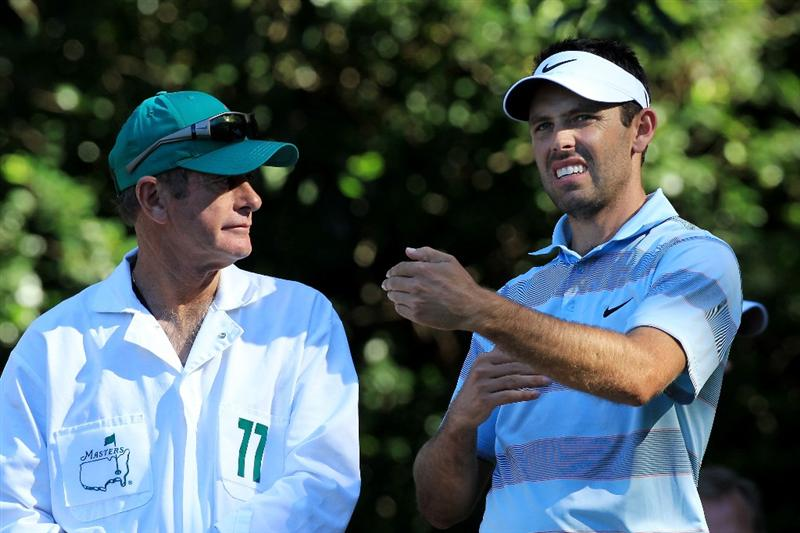 AUGUSTA, GA - APRIL 06:  Charl Schwartzel of South Africa waits with his caddie during the Par 3 Contest prior to the 2011 Masters Tournament at Augusta National Golf Club on April 6, 2011 in Augusta, Georgia.  (Photo by David Cannon/Getty Images)