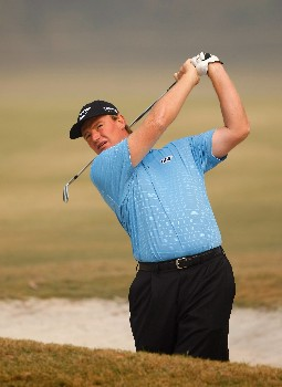 NEW DELHI, INDIA - FEBRUARY 06: Ernie Els of South Africa plays a fairway bunker shot during the Pro - Am at the Emaar-MGF Indian Masters at the Delhi Golf Club on February 6, 2008 in Delhi, India.  (Photo by Stuart Franklin/Getty Images)