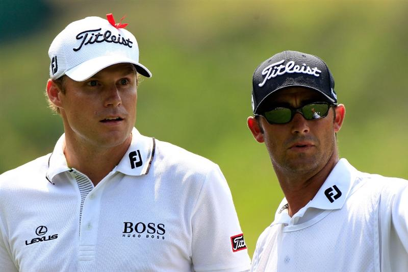 PONTE VEDRA BEACH, FL - MAY 13:  (L-R) Nick Watney and caddie Chad Reynolds look on from the ninth hole during the second round of THE PLAYERS Championship held at THE PLAYERS Stadium course at TPC Sawgrass on May 13, 2011 in Ponte Vedra Beach, Florida.  (Photo by Sam Greenwood/Getty Images)
