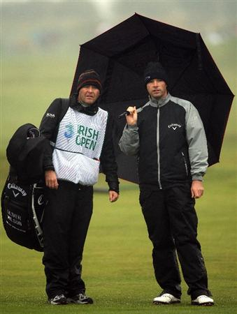 BALTRAY, IRELAND - MAY 15:  Oliver Wilson of England waits with his caddie Richard Hill on the 18th hole during the second round of The 3 Irish Open at County Louth Golf Club on May 15, 2009 in Baltray, Ireland.  (Photo by Andrew Redington/Getty Images)