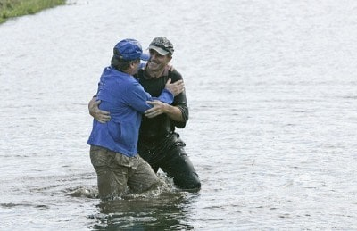 Jerry Pate and Chris Sullivan of Outback jump in the lake at 18 after Pate wins the 2006 Outback Steakhouse Pro-Am, held at TPC of Tampa Bay in Lutz, Florida, on February 26, 2006.Photo by: Chris Condon/PGA TOUR