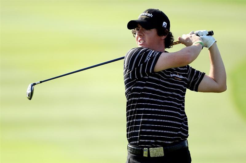 ABU DHABI, UNITED ARAB EMIRATES - JANUARY 22:  Rory McIlroy of Northern Ireland hits his second shot on the 18th hole during the second round of The Abu Dhabi Golf Championship at Abu Dhabi Golf Club on January 22, 2010 in Abu Dhabi, United Arab Emirates.  (Photo by Andrew Redington/Getty Images)