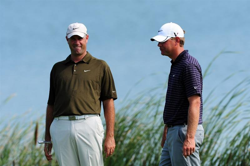 CHASKA, MN - AUGUST 14:  Stewart Cink and Lucas Glover wait on the 16th green during the second round of the 91st PGA Championship at Hazeltine National Golf Club on August 14, 2009 in Chaska, Minnesota.  (Photo by Stuart Franklin/Getty Images)