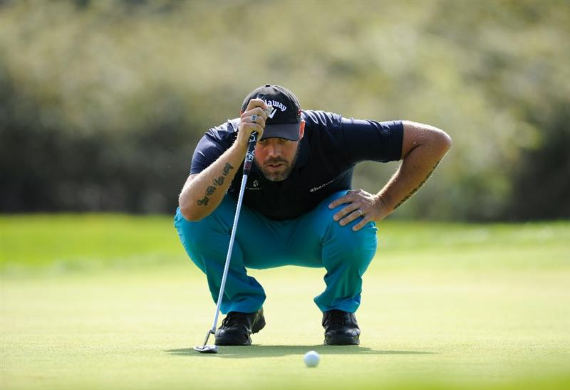 CASTELLON DE LA PLANA, SPAIN - OCTOBER 23:  Christian Nilsson of Sweden lines up his putt on the first hole during the third round of the Castello Masters Costa Azahar at the Club de Campo del Mediterraneo on October 23, 2010 in Castellon de la Plana, Spain.  (Photo by Stuart Franklin/Getty Images)