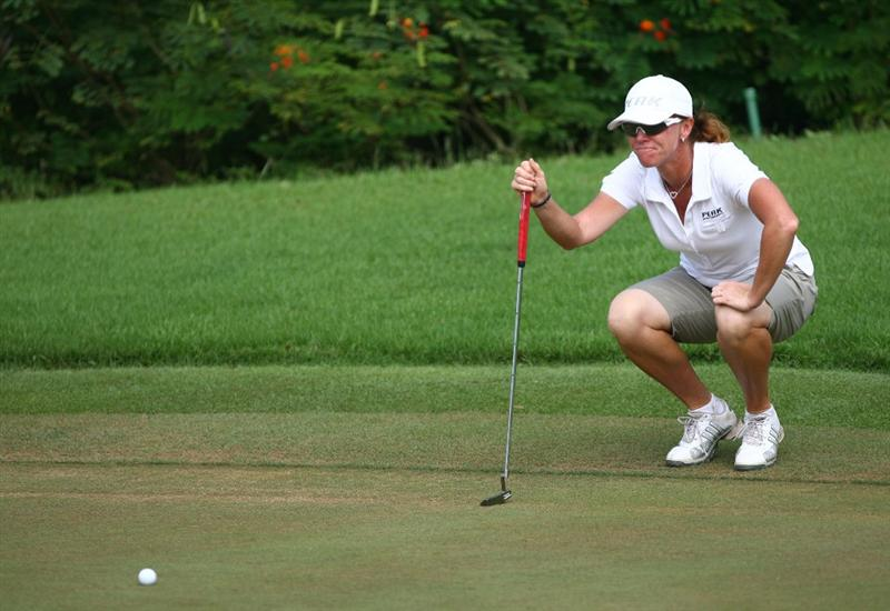 HAIKOU, CHINA - OCTOBER 26:  (CHINA OUT) Helen Alfredsson of Sweden lines up a putt on the 15th hole during day three of the Grand China Air LPGA 2008 on October 26, 2008 in Haikou, Hainan Province, China.  (Photo by China Photos/Getty Images)