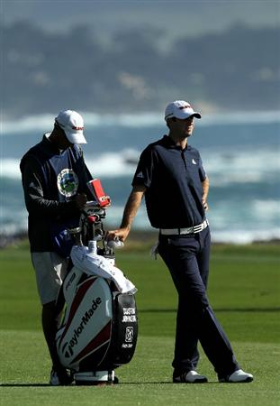 PEBBLE BEACH, CA - FEBRUARY 14:  Dustin Johnson waits to hit his second shot on the 18th hole during the final round of the AT&T Pebble Beach National Pro-Am at Pebble Beach Golf Links on February 14, 2010 in Pebble Beach, California.  (Photo by Stephen Dunn/Getty Images)