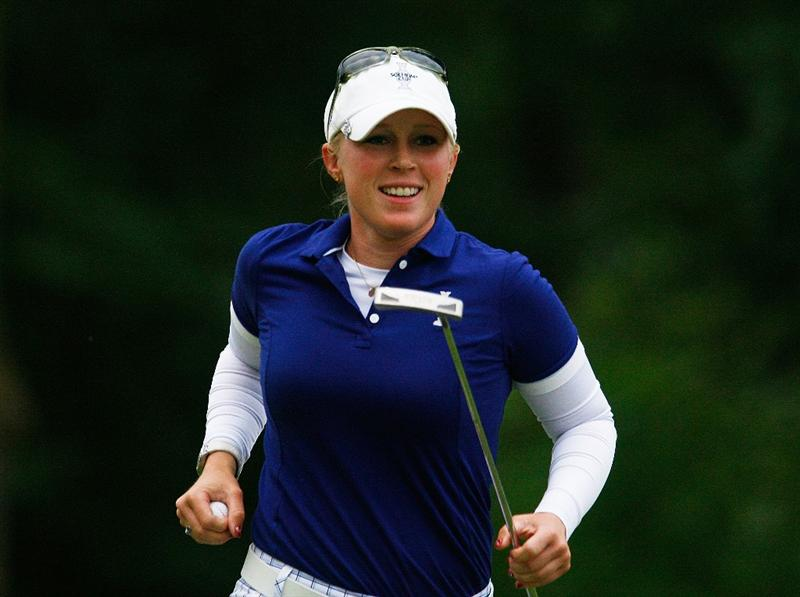 SUGAR GROVE, IL - AUGUST 22:  Morgan Pressel of the U.S. Team celebrates a birdie putt on the 16th green during the saturday afternoon foursomes matches at the 2009 Solheim Cup at Rich Harvest Farms on August 22, 2009 in Sugar Grove, Illinois.  (Photo by Scott Halleran/Getty Images)