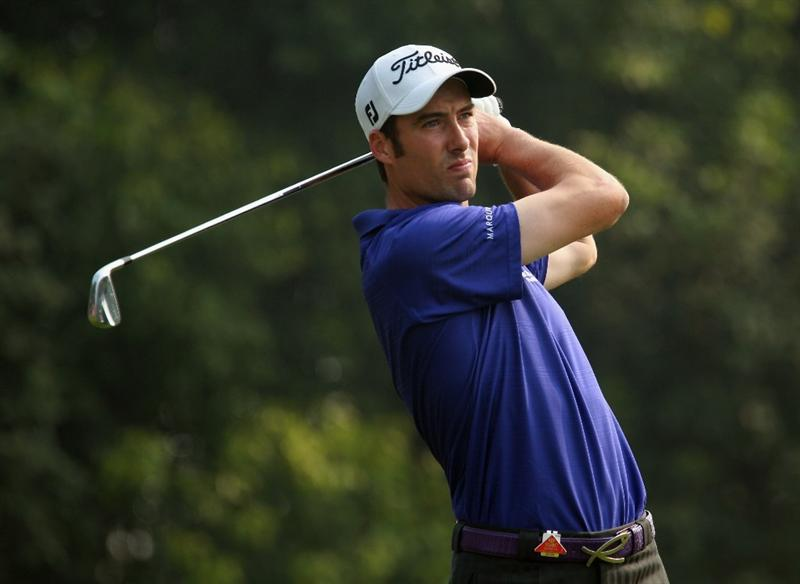 SHANGHAI, CHINA - NOVEMBER 07:  Ross Fisher of England watches his tee shot on the fourth hole during the final round of the WGC-HSBC Champions at the Sheshan Golf Club on November 7, 2010 in Shanghai, China.  (Photo by Scott Halleran/Getty Images)