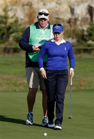 INCHEON, SOUTH KOREA - OCTOBER 29:  Morgan Pressel of United States lines up a putt with her caddy on the 16th green during the 2010 LPGA Hana Bank Championship at Sky 72 golf club on October 29, 2010 in Incheon, South Korea.  (Photo by Chung Sung-Jun/Getty Images)