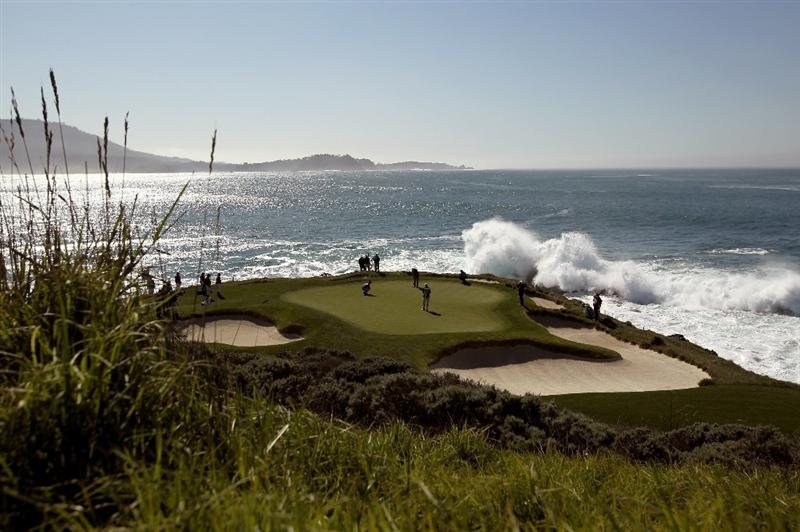PEBBLE BEACH, CA - FEBRUARY 14:  Dustin Johnson putts on the seventh hole during the final round of the AT&T Pebble Beach National Pro-Am at Pebble Beach Golf Links on February 14, 2010 in Pebble Beach, California.  (Photo by Ezra Shaw/Getty Images)