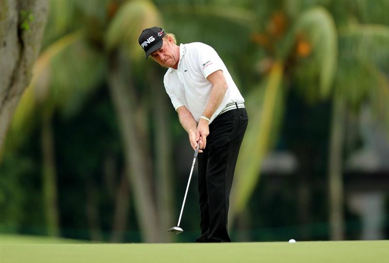 SINGAPORE - NOVEMBER 11: Miguel Angel Jimenez of Spain putts on the 16th hole during the First Round of the Barclays Singapore Open at Sentosa Golf Club on November 11, 2010 in Singapore, Singapore.  (Photo by Stanley Chou/Getty Images)