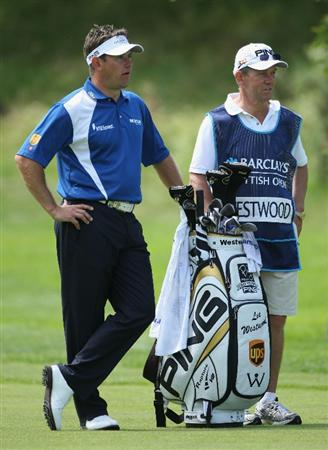 LUSS, SCOTLAND - JULY 11:  Lee Westwood of England looks on with caddy Dave McNeilly during the Third Round of The Barclays Scottish Open at Loch Lomond Golf Club on July 11, 2009 in Luss, Scotland.  (Photo by Andrew Redington/Getty Images)