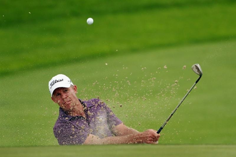 BAHRAIN, BAHRAIN - JANUARY 29:  James Kingston of South Africa plays a bunker shot on the 13th hole during the third round of the Volvo Golf Champions at The Royal Golf Club on January 29, 2011 in Bahrain, Bahrain.  (Photo by Andrew Redington/Getty Images)
