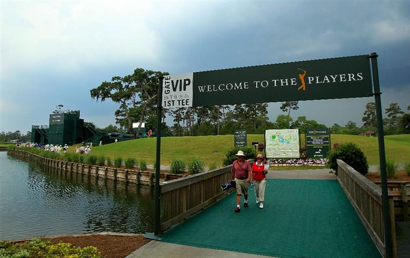 PONTE VEDRA BEACH, FL - MAY 14:  Fans leave the course after play was suspended due to severe storms during the third round of THE PLAYERS Championship held at THE PLAYERS Stadium course at TPC Sawgrass on May 14, 2011 in Ponte Vedra Beach, Florida.  (Photo by Streeter Lecka/Getty Images)