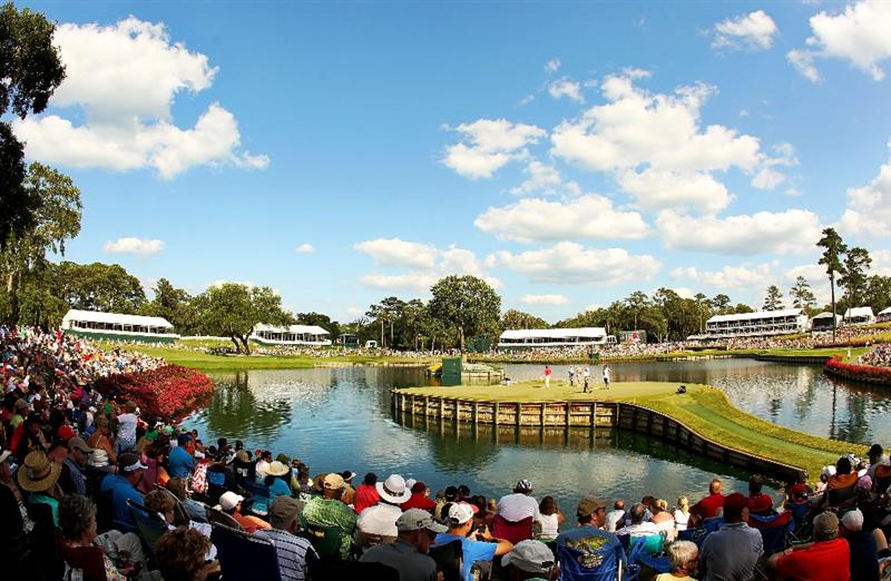 PONTE VEDRA BEACH, FL - MAY 15:  A gallery of fans watch play on the 17th green during the final round of THE PLAYERS Championship held at THE PLAYERS Stadium course at TPC Sawgrass on May 15, 2011 in Ponte Vedra Beach, Florida.  (Photo by Mike Ehrmann/Getty Images)