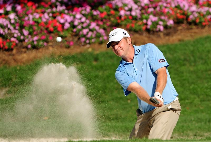 PONTE VEDRA BEACH, FL - MAY 07:  Jason Bohn plays from a bunker on the 14th hole during the second round of THE PLAYERS Championship held at THE PLAYERS Stadium course at TPC Sawgrass on May 7, 2010 in Ponte Vedra Beach, Florida.  (Photo by Sam Greenwood/Getty Images)