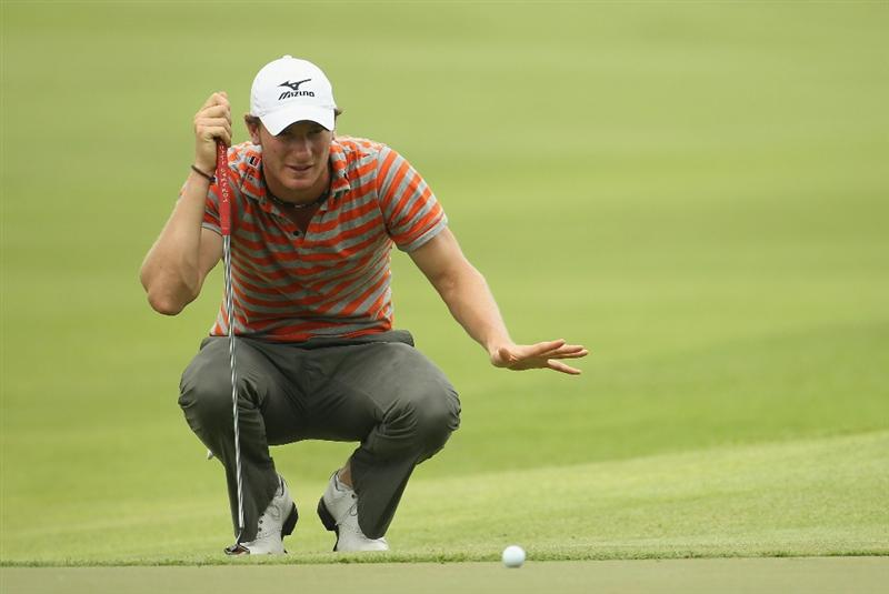 SINGAPORE - NOVEMBER 11:  Chris Wood of England lines up a put on the 6th green during the First Round of the Barclays Singapore Open at Sentosa Golf Club on November 11, 2010 in Singapore, Singapore.  (Photo by Ian Walton/Getty Images)