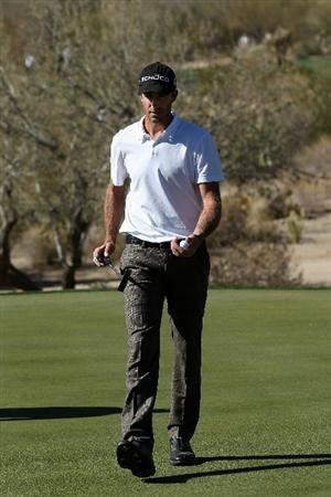 MARANA, AZ - FEBRUARY 24:  Geoff Ogilvy of Australia walks off the 17th hole during the second round of the Accenture Match Play Championship at the Ritz-Carlton Golf Club on February 24, 2011 in Marana, Arizona.  (Photo by Sam Greenwood/Getty Images)