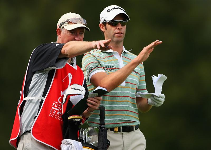 CRANS, SWITZERLAND - SEPTEMBER 05:  Bradley Dredge of Wales receives some advice from his caddie Nick Fidgeon on the 12th hole during the second round of the Omega European Masters at Crans-Sur-Sierre Golf Club on September 5, 2008 in Crans Montana, Switzerland.  (Photo by Andrew Redington/Getty Images)
