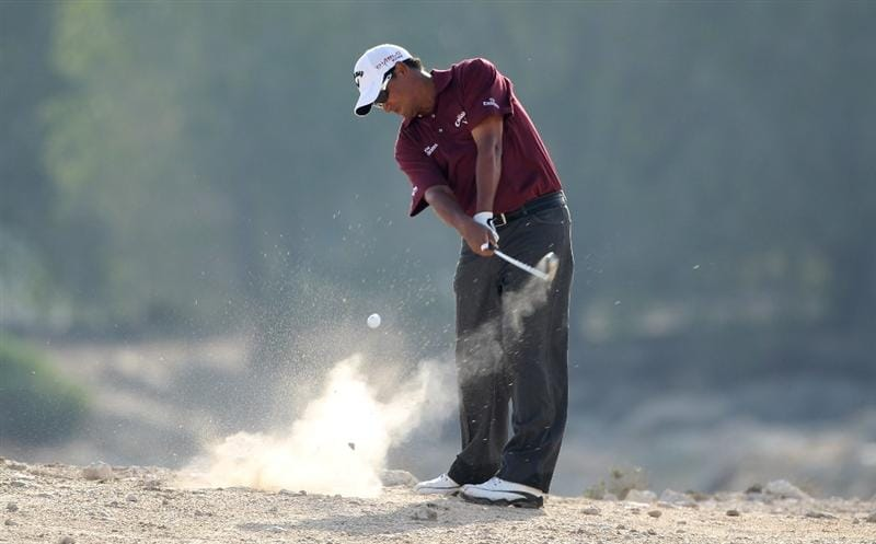 DOHA, QATAR - JANUARY 29:  Michael Campbell of New Zealand hits his second shot on the 14th hole during the second round of the Commercialbank Qatar Masters at Doha Golf Club on January 29, 2010 in Doha, Qatar.  (Photo by Andrew Redington/Getty Images)