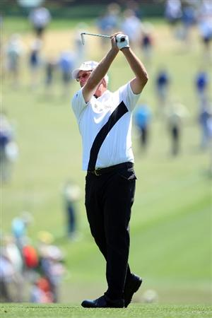 AUGUSTA, GA - APRIL 12:  Sandy Lyle of Scotland hits his approach shot on the first hole during the final round of the 2009 Masters Tournament at Augusta National Golf Club on April 12, 2009 in Augusta, Georgia.  (Photo by Andrew Redington/Getty Images)