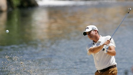 MALELANE, SOUTH AFRICA - DECEMBER 05:  Francois Delamontagne of France plays out of a greenside bunker on the ninth hole during a practice round of the Alfred Dunhill Championship at The Leopard Creek Country Club on December 5, 2007 in Malelane, South Africa.  (Photo by Warren Little/Getty Images)