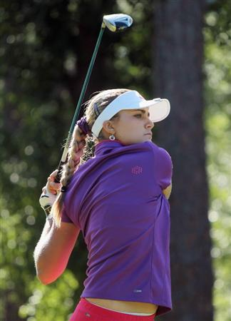 MOBILE, AL - APRIL 28:  Alexis Thompson watches her tee shot on the fifth hole during the first round of the Avnet LPGA Classic at the Crossings Course at the Robert Trent Jones Trail at Magnolia Grove on April 28, 2011 in Mobile, Alabama.  (Photo by Scott Halleran/Getty Images)