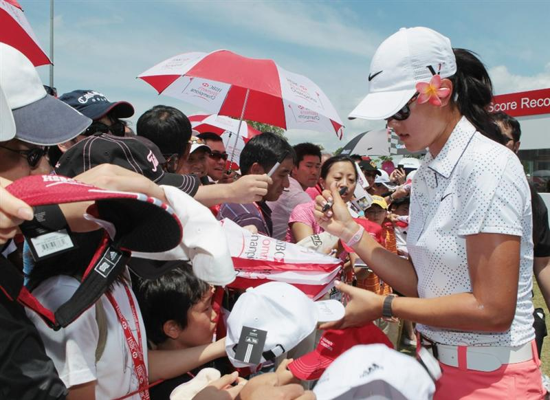 SINGAPORE - FEBRUARY 26:  Michelle Wie of the USA signs autographs for fans after the third round of the HSBC Women's Champions 2011 at the Tanah Merah Country Club on February 26, 2011 in Singapore, Singapore.  (Photo by Scott Halleran/Getty Images)