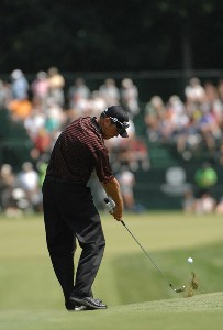 SILVIS, IL - JULY 14:  Neal Lancaster hits his approach shot into the 9th hole  during the third round of The John Deere Classic at the TPC Deere Run on July 14, 2007 in Silvis, Illinois.   (Photo by Marc Feldman/WireImage) *** Local Caption *** Neal Lancaster PGA TOUR - 2007 John Deere Classic - Third RoundPhoto by Marc Feldman/WireImage) *** Local Caption *** Neal Lancaster
