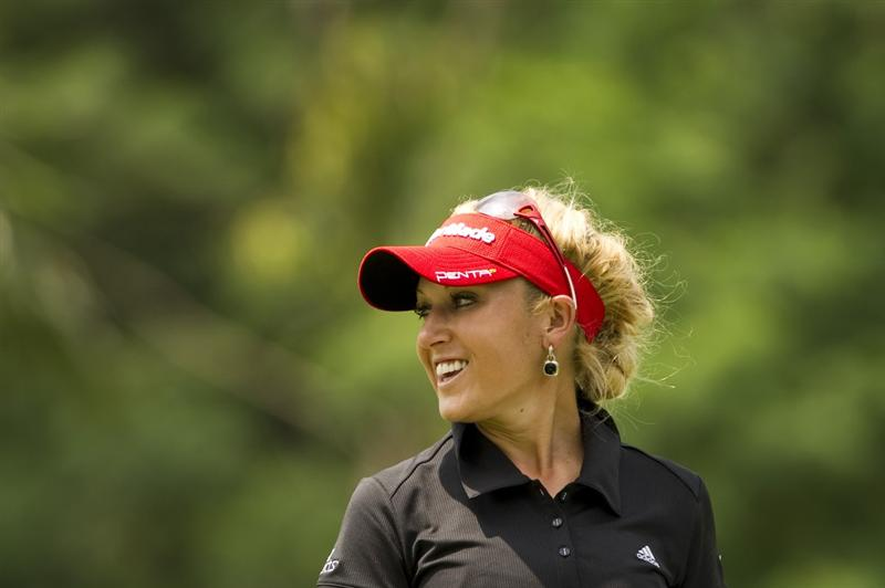 CHON BURI, THAILAND - FEBRUARY 21:  Natalie Gulbis of USA smiles on the 8th green during the final round of the Honda PTT LPGA Thailand at Siam Country Club on February 21, 2010 in Chon Buri, Thailand.  (Photo by Victor Fraile/Getty Images)