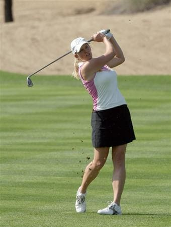 DUBAI, UNITED ARAB EMIRATES - DECEMBER 12: Johanna Head of England plays her third shot at the 13th hole during the second round of the Dubai Ladies Masters on the Majilis Course at the Emirates Golf Club on December 12, 2008 in Dubai,United Arab Emirates  (Photo by David Cannon/Getty Images)