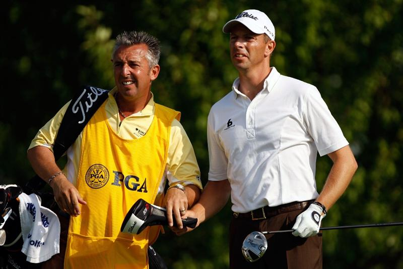 CHASKA, MN - AUGUST 13:  Soren Hansen of Denmark (R) waits with his caddie Phil Morbey on the third tee during the first round of the 91st PGA Championship at Hazeltine National Golf Club on August 13, 2009 in Chaska, Minnesota.  (Photo by Streeter Lecka/Getty Images)