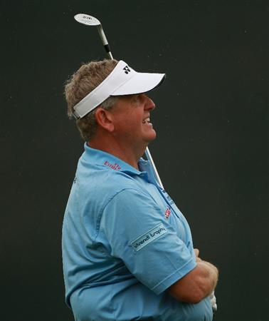 ABU DHABI, UNITED ARAB EMIRATES - JANUARY 21:  Colin Montgomerie of Scotland plays his third shot on the 18th hole during the second round of The Abu Dhabi HSBC Golf Championship at Abu Dhabi Golf Club on January 21, 2011 in Abu Dhabi, United Arab Emirates.  (Photo by Andrew Redington/Getty Images)
