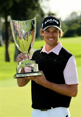 PACIFIC PALISADES, CA - FEBRUARY 20:  Aaron Baddeley of Australia poses with the trophy after the final round of the Northern Trust Open at Riviera Country Club on February 20, 2011 in Pacific Palisades, California.  (Photo by Stephen Dunn/Getty Images)