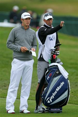 PEBBLE BEACH, CA - JUNE 18:  Dustin Johnson talks to his caddie Bobby Brown during the second round of the 110th U.S. Open at Pebble Beach Golf Links on June 18, 2010 in Pebble Beach, California.  (Photo by Donald Miralle/Getty Images)