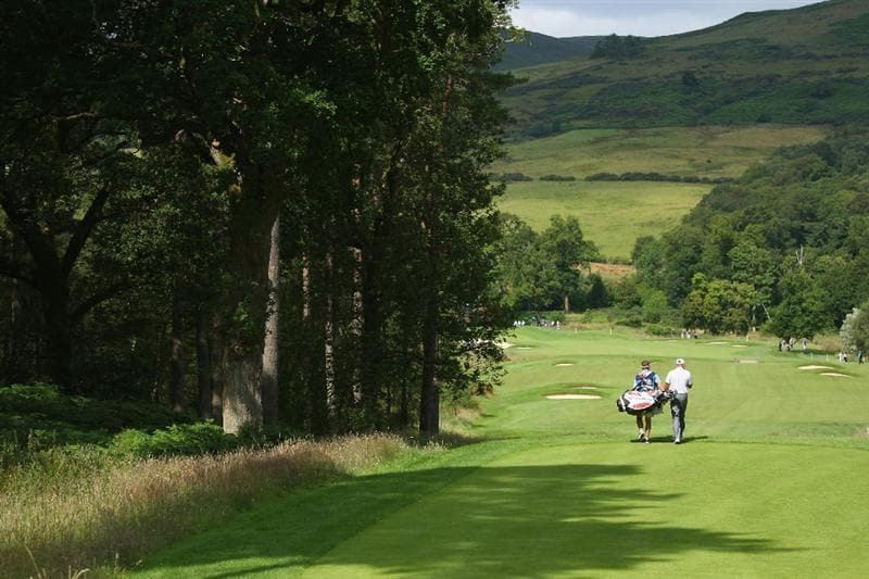 LUSS, SCOTLAND - JULY 09:  Graeme Storm of England walks down the 13th hole with his caddy during the First Round of The Barclays Scottish Open at Loch Lomond Golf Club on July 09, 2009 in Luss, Scotland.  (Photo by Andrew Redington/Getty Images)