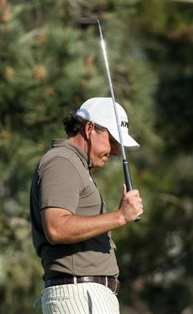 LA JOLLA, CA - JANUARY 29:  Phil Mickelson reacts to a missed birdie putt on the 17th hole during Round 3 of the Farmers Insurance Open at Torrey Pines on January 29, 2011 in La Jolla, California. (Photo by Donald Miralle/Getty Images)
