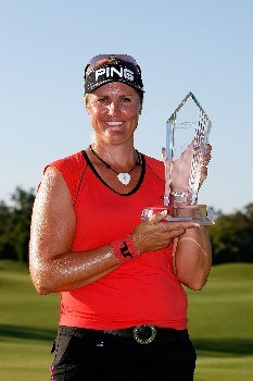 PRATTVILLE, AL - SEPTEMBER 30:  Maria Hjorth celebrates with the winner's trophy after the final round of the Navistar LPGA Classic at the Robert Trent Jones Golf Trail at Capitol Hill on September 30, 2007 in Prattville, Alabama. Hjorth won the tournament at a total of 14 under par.  (Photo by Chris Graythen/Getty Images)