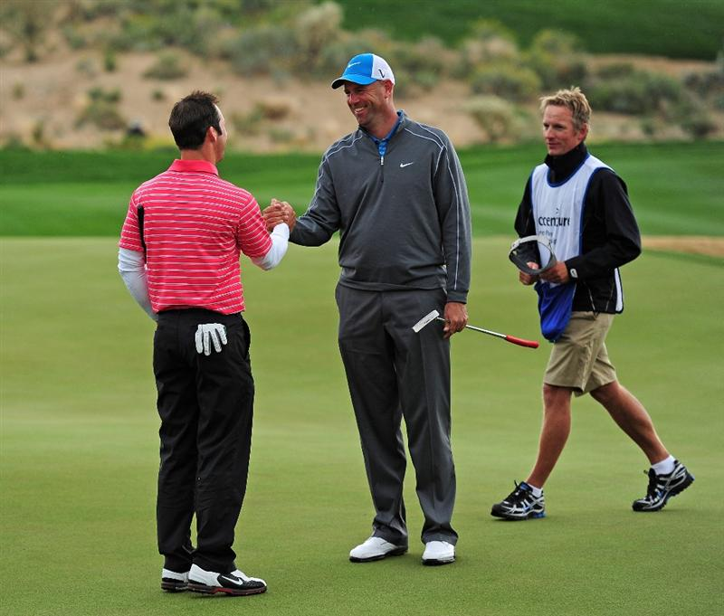 MARANA, AZ - FEBRUARY 20:  Stewart Cink congraulates Paul Casey of England on the 14th hole during round four of the Accenture Match Play Championship at the Ritz-Carlton Golf Club on February 20, 2010 in Marana, Arizona.  (Photo by Stuart Franklin/Getty Images)