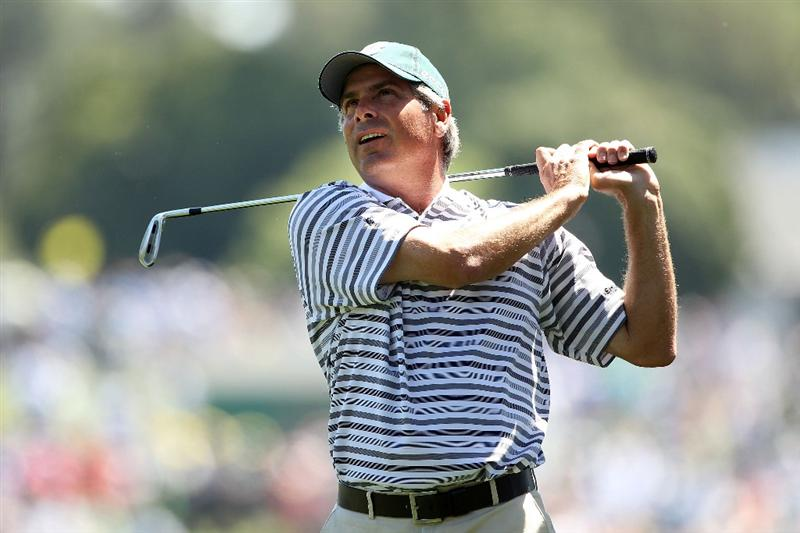 AUGUSTA, GA - APRIL 07:  Fred Couples hit his second shot on the first hole during the first round of the 2011 Masters Tournament at Augusta National Golf Club on April 7, 2011 in Augusta, Georgia.  (Photo by Andrew Redington/Getty Images)