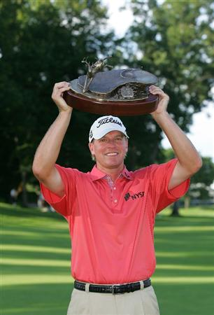 SILVIS, IL - JULY 12:  Steve Stricker of the USA holds the trophy after winning the John Deere Classic at TPC Deere Run held on July 12, 2009 in Silvis, Illinois.  (Photo by Michael Cohen/Getty Images)