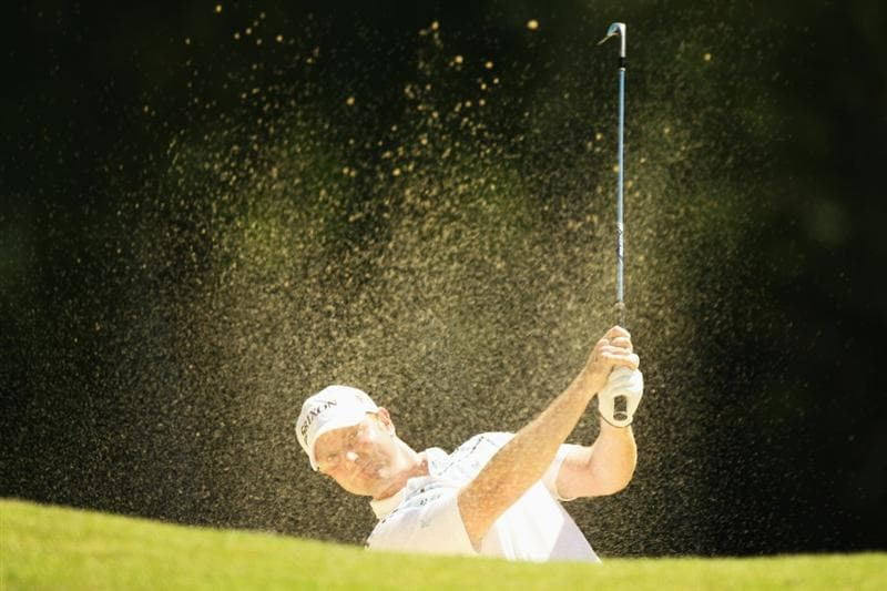 VIRGINIA WATER, ENGLAND - MAY 22:  Richard McEvoy of England plays out of a bunker on the 6th hole during the third round of the BMW PGA Championship on the West Course at Wentworth on May 22, 2010 in Virginia Water, England.  (Photo by Warren Little/Getty Images)