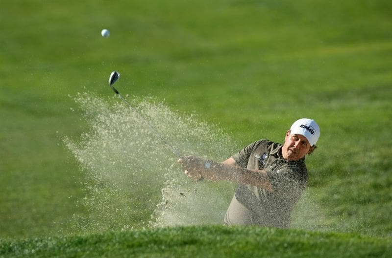 LA JOLLA, CA - JANUARY 29:  Phil Mickelson hits the ball out of the 6th bunker during Round 3 of the Farmers Insurance Open at Torrey Pines on January 29, 2011 in La Jolla, California. (Photo by Donald Miralle/Getty Images)
