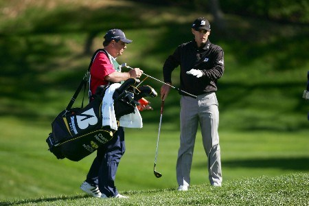 LA JOLLA, CA - JANUARY 24:  Charles Howell III (R) takes his putter on the 14th hole during the first round of the Buick Invitational at the Torrey Pines Golf Course January 24, 2008 in La Jolla, California.  (Photo by Harry How/Getty Images)