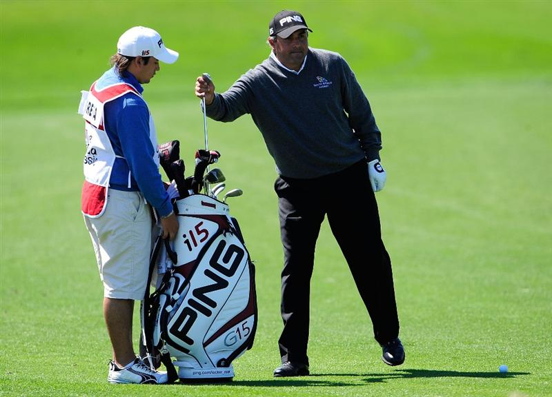 PALM BEACH GARDENS, FL - MARCH 05:  Angel Cabrera of Argentina takes selects a club from his son Angel during the second round of the Honda Classic at PGA National Resort And Spa on March 5, 2010 in Palm Beach Gardens, Florida.  (Photo by Sam Greenwood/Getty Images)