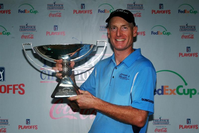 ATLANTA - SEPTEMBER 26:  Jim Furyk celebrates with the FedExCup Trophy after winning THE TOUR Championship presented by Coca-Cola, the final event of the PGA TOUR Playoffs for the FedExCup, at East Lake Golf Club on September 26, 2010 in Atlanta, Georgia.  (Photo by Scott Halleran/Getty Images)